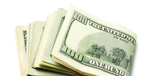 Stack of Folded US Currency Notes on White background