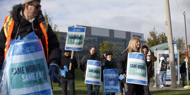 Striking faculty members stand on the picket line outside of Humber College in Toronto on Oct. 16, 2017.