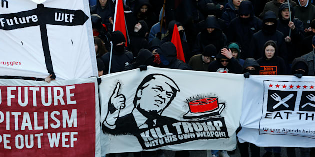Protesters with banners march during an anti-WEF and anti-U.S. President Donald Trump demonstration, ahead of Trump's visit to the World Economic Forum (WEF), in Bern, Switzerland, January 13, 2018.  REUTERS/Arnd Wiegmann