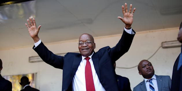 Jacob Zuma, former president of South Africa waves to his supporters on his way to the high court in Durban, South Africa, April 6, 2018.