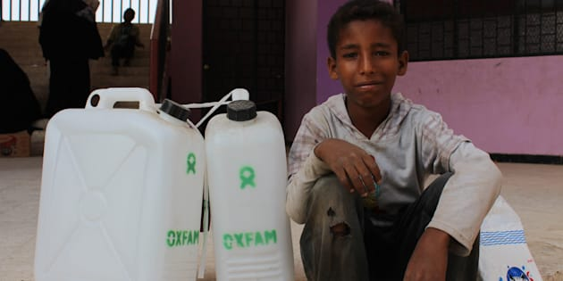 10-year-old Noran with Oxfam hygiene kits as part of a cholera response in Yemen.