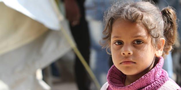Una niña palestina refugiada en un campo en Siria.
