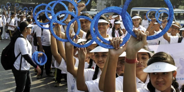 School students flash blue rings symbolic of diabetes during a rally on World Diabetes Day in Kolkata, India, in 2013. (AP Photo/Bikas Das)