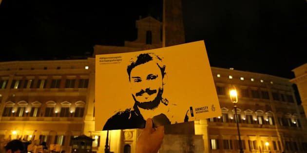 REFILE-CORRECTING BYLINE A man holds a placard during a vigil to commemorate Giulio Regeni, who was found murdered in Cairo a year ago, in downtown Rome, Italy January 25, 2017. REUTERS/Alessandro Bianchi