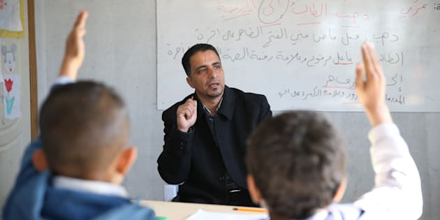 44-year-old Syrian refugee Hudur Omar Ilgeya lectures the refugee children at a temporary education centre in Reyhanli District of Hatay, Turkey on Nov. 23, 2016.