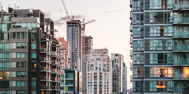 Vancouver home sales plunge to 18-year low, but prices barely budge