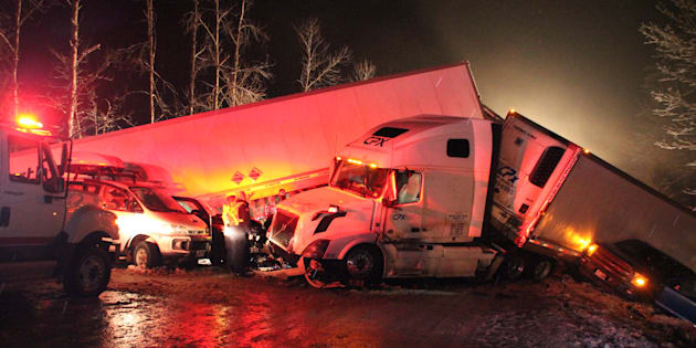 First responders and highways crews worked through the night east of Vancouver to help people in a multi-vehicle pileup on an icy stretch of the Coquihalla Highway, north of Hope, on Feb. 25, 2018.  (Shane MacKichan/Canadian Press)