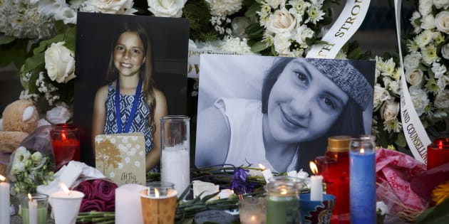 Photos of victims Julianna Kozis, 10, left, and Reese Fallon, 18, are seen during a vigil for victims of Sunday night's mass shooting on Danforth Ave. on July 25, 2018 in Toronto, Canada.