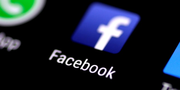 The Facebook application is seen on a phone screen Aug. 3, 2017.
