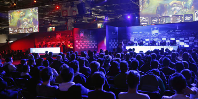 Fans watch an electronic video game tournament with the game 'League of Legends' developed by Riot Games during the 'Paris Games Week' on October 28, 2016 in Paris, France.  '
