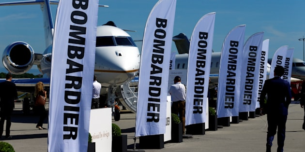 People attend the Bombardier stand during the European Business Aviation Convention & Exhibition (EBACE) at Cointrin airport in Geneva, Switzerland, May 22, 2017.