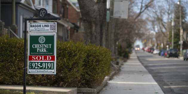 A for sale sign for a house in Toronto's St. Clair and Arlington neighbourhood. New polling data from the city's real estate board suggests many first-time home buyers are giving up on the city.