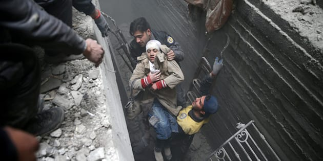 Syria Civil Defence members help an unconscious woman from a shelter in the besieged town of Douma, Eastern Ghouta, Damascus, Syria February 22, 2018. REUTERS/Bassam Khabieh TPX IMAGES OF THE DAY