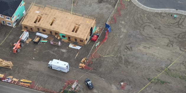 An aerial photograph shows the scene where Calgary police say three bodies were found inside a burning vehicle.