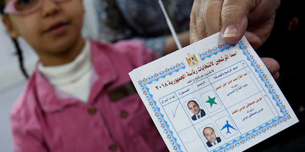 An Egyptian woman shows her ballot paper with sign for Egypt's President Abdel Fattah al-Sisi before casting her vote during the first day of the presidential election at a polling station in Cairo, Egypt, March 26, 2018. REUTERS/Amr Abdallah Dalsh