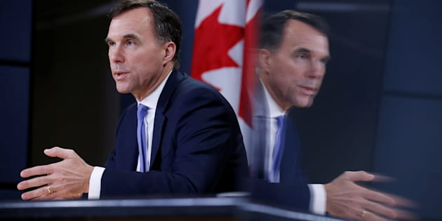 Finance Minister Bill Morneau is reflected on a monitor while speaking during a news conference about the state of the Kinder Morgan pipeline expansion in Ottawa on May 16, 2018.