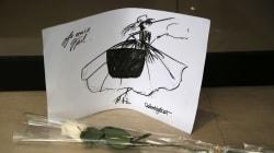 Fanáticos de Karl Lagerfeld dejan flores en boutique de