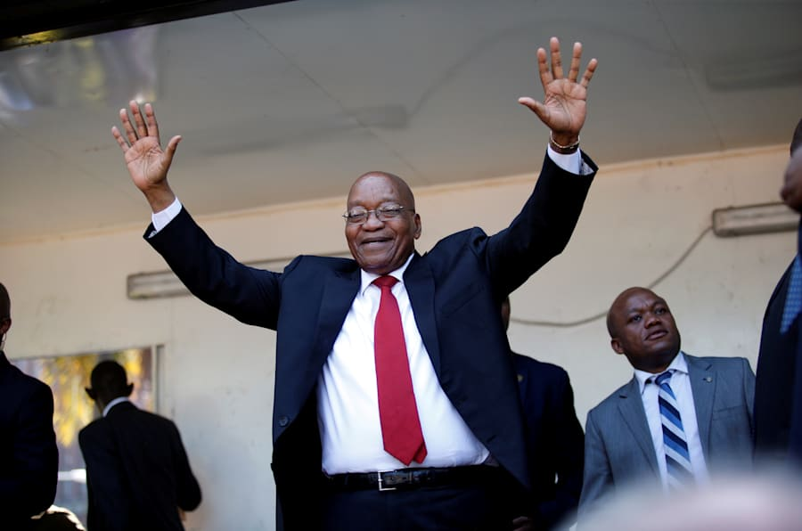Jacob Zuma, former president of South Africa, waves to his supporters on his way to the high court in Durban. April 6, 2018.