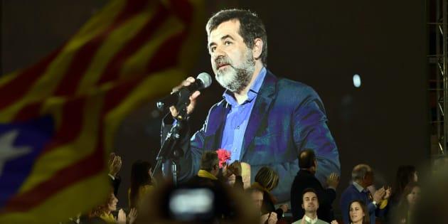 Jordi Sànchez aparece en una pantalla en un mitin de Junts per Catalunya en la campaña electoral.