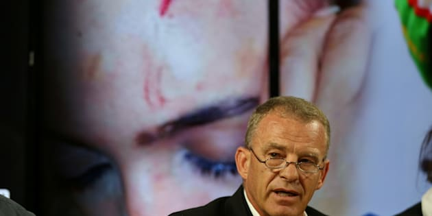 Advocate Gerrie Nel addresses a news conference with Gabriella Engels, who claims to have been assaulted by Grace Mugabe, in Pretoria this month. REUTERS/Siphiwe Sibeko