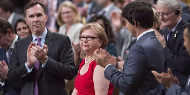 Liberal MP Judy Foote is given a standing ovation by members of Parliament as they pay tribute to her in the House of Commons in Ottawa on Sept. 28, 2017.