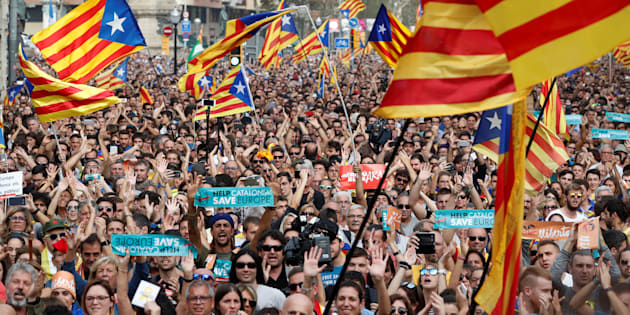 People react while the Catalan regional parliament votes for independence of Catalonia from Spain in Barcelona, Oct. 27, 2017.