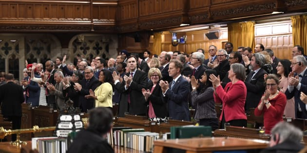 Liberal MPs rise for a standing ovation after Speaker of the House stated that Bill C-210 had received royal assent in Ottawa on Wednesday.
