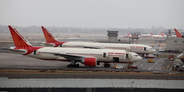 Air India aircrafts are seen parked on the tarmac of the international airport in Mumbai.