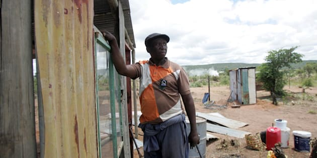 Joseph Tswago builds a shack as part of the alleged Economic Freedom Fighters (EFF) land grab campaign in January 2017 in Modimolle, South Africa. About 2 000 people claimed to have been given free stands in a land grab campaign backed by the EFF.