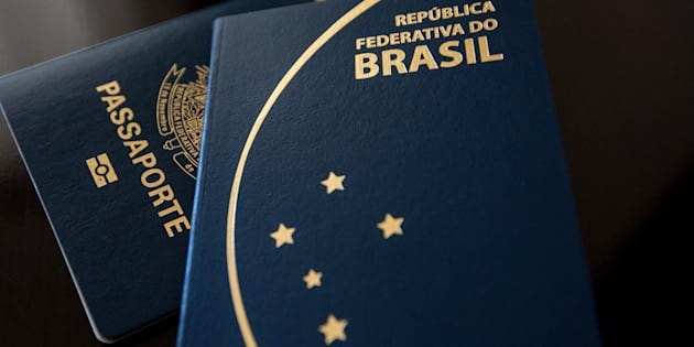 Sao Paulo, Brazil, June 28, 2017. Brazilian passport. 2 different models in dark and clear background