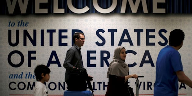 International passengers arrive at Washington Dulles International Airport in Virginia, U.S., June 26, 2017.