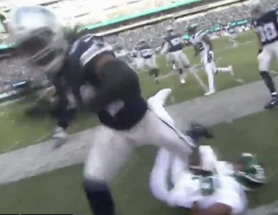 Sideline cameraman films his own tumble after hit
