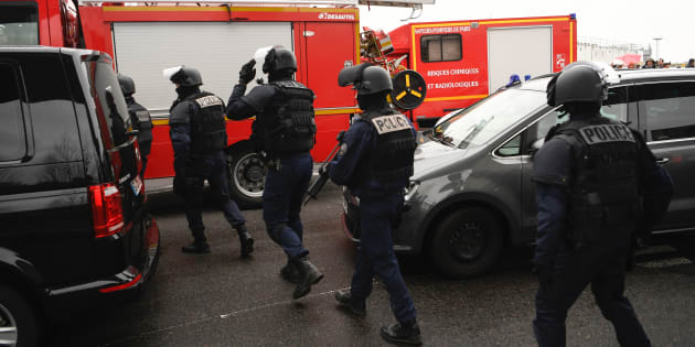 French policemen and firefighters secure the area at Paris' Orly airport on March 18, 2017 following the shooting of a man by French security forces. Security forces at Paris' Orly airport shot dead a man who took a weapon from a soldier, the interior ministry said. Witnesses said the airport was evacuated following the shooting at around 8:30am (0730GMT). The man fled into a shop at the airport before he was shot dead, an interior ministry spokesman told AFP. He said there were no people were wounded in the incident.  / AFP PHOTO / CHRISTOPHE SIMON        (Photo credit should read CHRISTOPHE SIMON/AFP/Getty Images)