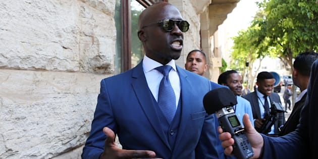 Finance Minister Malusi Gigaba speaks to members of the media after delivering his medium term budget speech in Parliament, in Cape Town, South Africa, October 25, 2017.