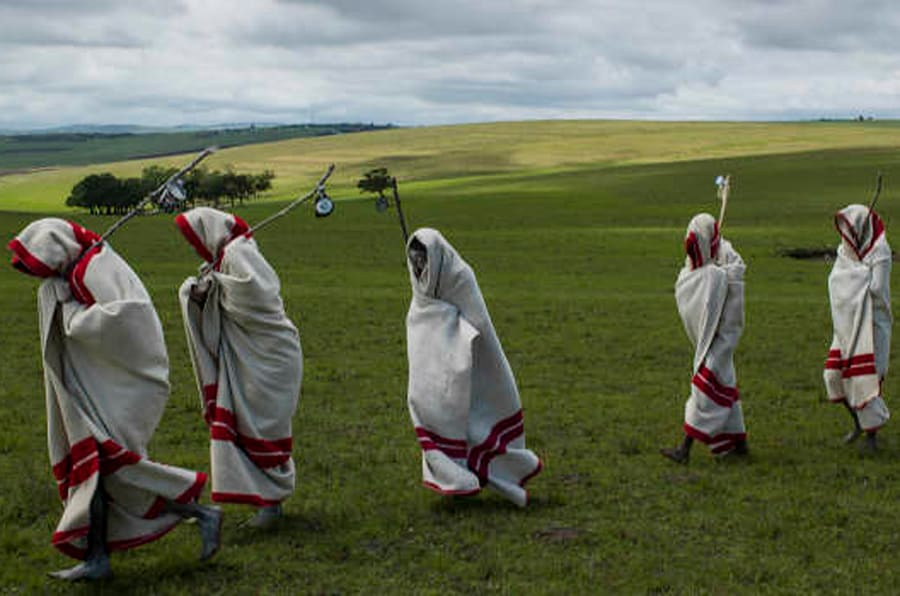 Xhosa Initiates pass by close to the funeral of Nelson Mandela, Qunu, South Africa, 14 December 2014.