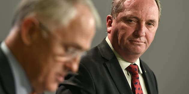 Australia's Deputy Prime Minister Barnaby Joyce (R) looks at Prime Minister Malcolm Turnbull (L) addressing a press conference in  after Turnbull rejected calls for him to resign after the disastrous 2016 election.
