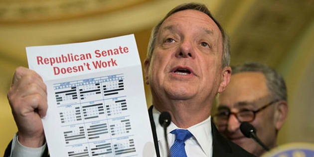 Senate Minority Whip Richard Durbin of Ill., accompanied by Sen. Charles Schumer, D-N.Y., holds up a calendar during a news conference on Capitol Hill in Washington, Tuesday, May 24, 2016. (AP Photo/Evan Vucci)