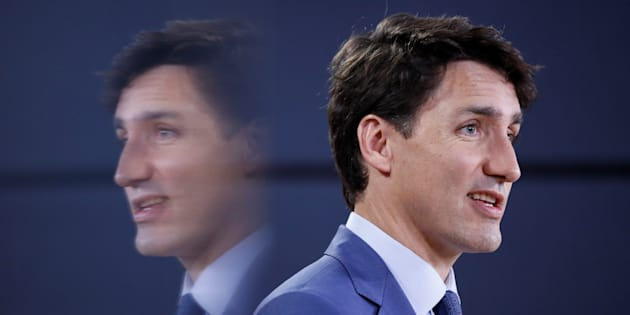 Prime Minister Justin Trudeau is reflected in a monitor while speaking during a news conference in Ottawa on June 20, 2018.