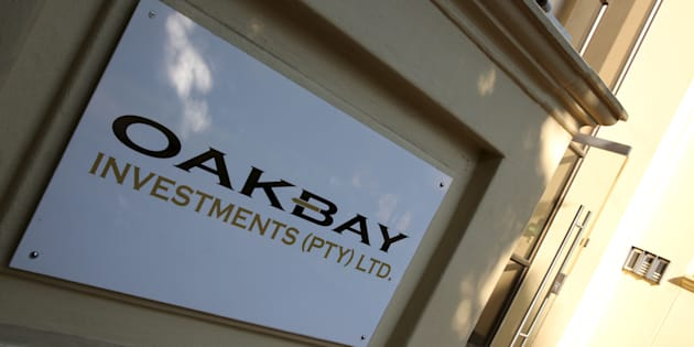 A logo of Oakbay Investments is seen at the entrance of their offices in Sandton, outside Johannesburg, April 13, 2016.