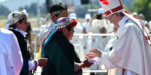 Mapuches participate in an open-air mass celebrated by Pope Francis at Maquehue airport in Temuco, 800 km south of Santiago, on January 17, 2018.