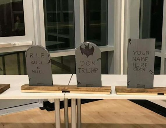 Principal apologizes for Trump tombstone at event