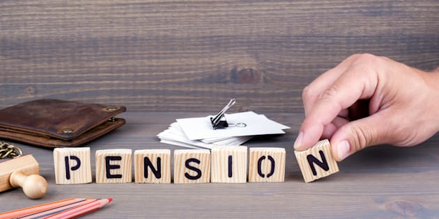pension concept.Wooden letters on dark background. Office desk