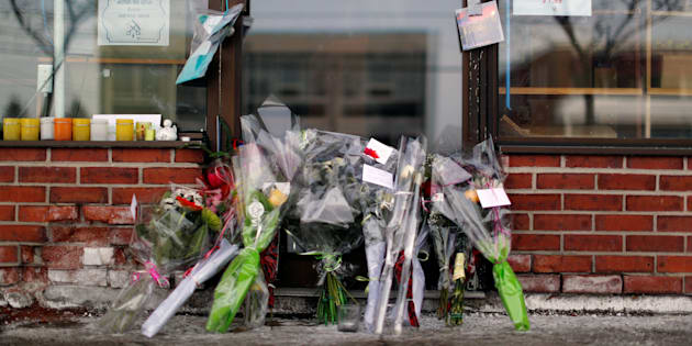 Flowers are pictured beside the grocery store owned by Azzeddine Soufiane, a victim of the fatal shooting at the Quebec Islamic Cultural Centre, in Quebec City, on Jan. 31, 2017.