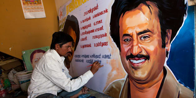 An artist working on a poster of Rajnikanth.