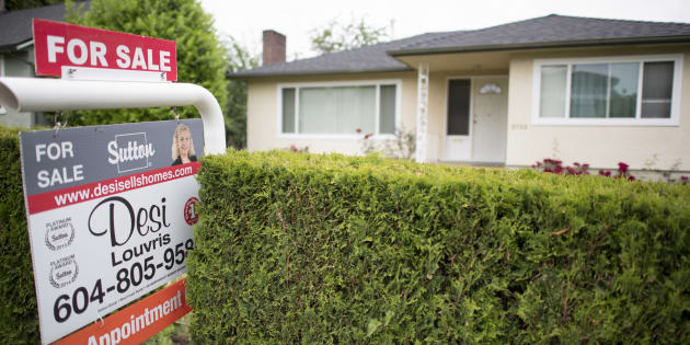 A real estate sign is pictured in Vancouver, B.C., Tues. June, 12, 2018. The Canada Mortgage and Housing Corporation says homebuyers in Toronto, Vancouver and Montreal believe foreign buyers are heavily influencing their markets.
