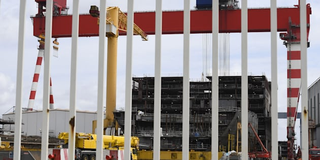 This general view shows an under-construction cruise ship at The STX Shipyard in Saint-Nazaire, western France on July 27, 2017.   France will nationalise the STX shipyard, a leading builder of cruise ships, Economy Minister Bruno Le Maire has announced, raising the stakes in a dispute with Italy over control of the site. / AFP PHOTO / DAMIEN MEYER        (Photo credit should read DAMIEN MEYER/AFP/Getty Images)