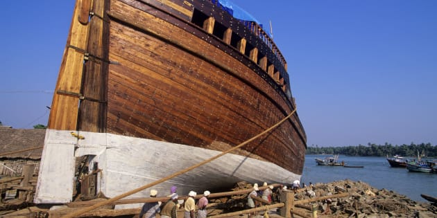 Dhow, a traditional Indian sailing vessel, under construction at the port in Beypore, Kerala.