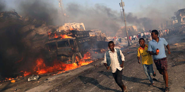Civilians evacuate from the scene of an explosion in Hodan district of Mogadishu, Somalia on Saturday.