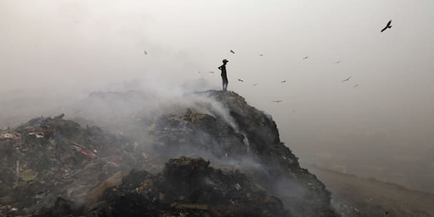 Garbage burning adding pollution to environment at Bhalswa Landfill as smog covers the capital's skyline