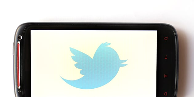 Bucharest, Romania - March 28, 2012: Twitter logo is displayed on a mobile phone screen. Twitter is an online social networking service and microblogging service that enables its users to send and read text-based posts.